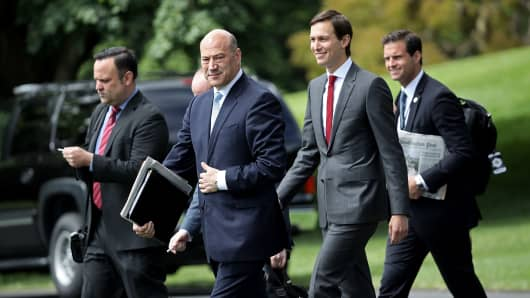 Gary Cohn (2nd L), White House chief economic advisor to U.S. President Donald Trump, and Trump's son-in-law and senior advisor Jared Kushner (2nd R) depart the White House June 7, 2017 in Washington, DC.