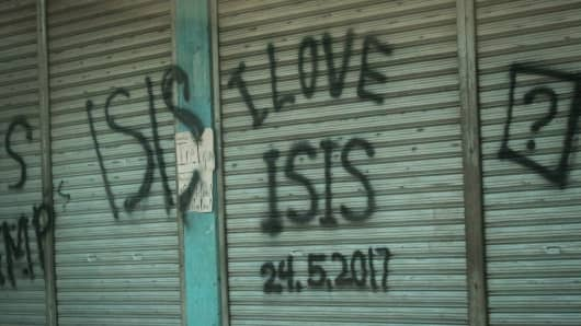 "Abandoned house vandalized with quote ""I LOVE ISIS"" is seen in a door of a house inside of a no-go zone in Marawi, southern Philippines."
