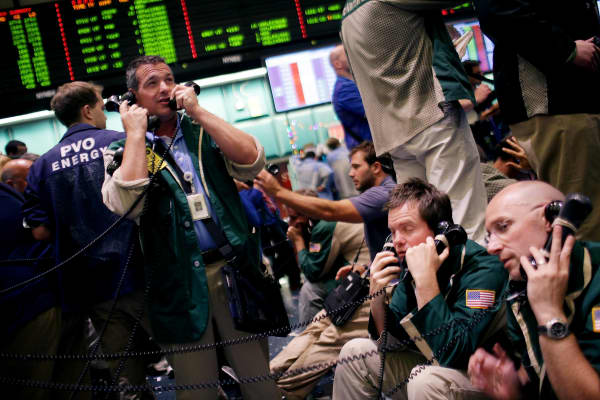 Traders work in the crude oil and natural gas options pit on the floor of the New York Mercantile Exchange on June 20, 2011 in New York City.