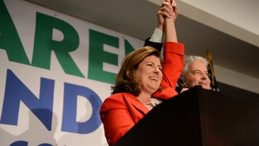 Karen Handel, Republican candidate for Georgia's 6th Congressional District, with husband Steve Handel at her side, gives her acceptance speech to supporters at her election night party at the Hyatt Regency at Villa Christina in Atlanta, Georgia, U.S., June 20, 2017.