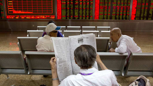 Investors wait for the start of the afternoon trading at a brokerage in Beijing, China, Wednesday, June 21, 2017. Global stock benchmark provider MSCI has made a long-awaited decision to add mainland China-listed shares to its widely followed stock indexes.