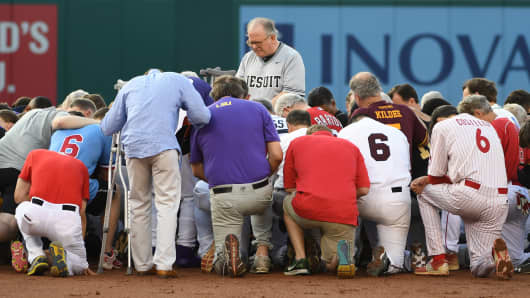 Democrats and Republicans gather at second base for a prayer prior to the start of the Congressional baseball game with the house chaplain leading the way on June 15, 2017 in Washington, DC.