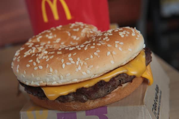 A Quarter Pounder hamburger is served at a McDonald's restaurant on March 30, 2017 in Effingham, Illinois. McDonald's announced today that it will start making the burger with fresh beef patties instead of the frozen beef that it currently uses.