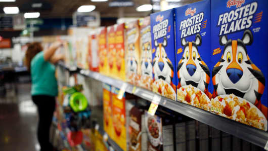 Kellogg's Frosted Flakes cereal is displayed for sale inside a Kroger grocery store in Louisville, Kentucky.