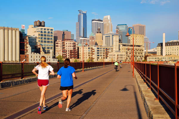 A file photo showing joggers on the Stone Arch Bridge in Minneapolis, Minnesota.