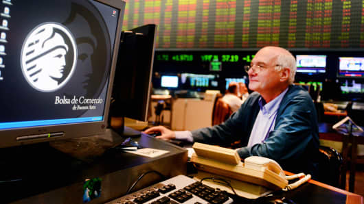 A trader works on the floor of the Buenos Aires Stock Exchange in Buenos Aires, Argentina.