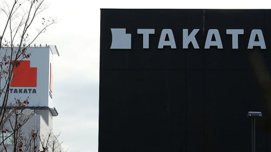 Signage for Takata are displayed at the company's Echigawa plant in Echigawa, Shiga, Japan, on Friday, Nov. 25, 2016.