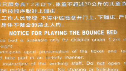 An English sign in a park instructs children how to play on a 'bounce bed' - meaning 'trampoline' - in Beijing, China, on April 11, 2007.
