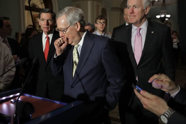 Senate Majority Leader Mitch McConnell, (center) R-Ky., approaches the microphones at the Capitol, June 20, 2017.