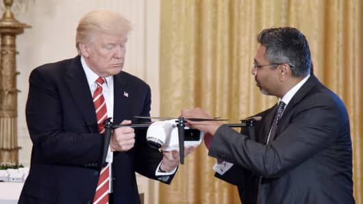 President Donald Trump holds a drone as George Mathew CEO & Chairman of Kespry explains how it work during the American Leadership in Emerging Technology Event in the East Room of the White House June 22, 2017 in Washington, DC.