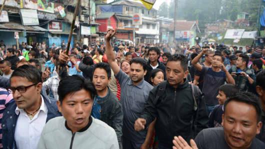 Indian supporters of the separatist Gorkha Janmukti Morcha group demonstrate during an indefinite strike called in Darjeeling on June 19, 2017. Hundreds of protesters paraded with coffins containing the bodies of two men they were were killed in clashes.