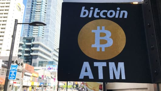 A sign is seen outside a business where a Bitcoin ATM is located in Toronto, Ontario, Canada June 3, 2017.