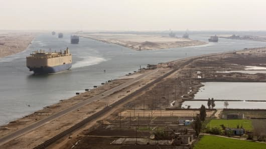 Cargo ships navigate in the Suez Canal between Port Said and Ismailia, about 100 kms northeast of Cairo.