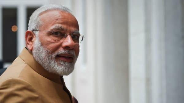 Indian Prime Minister Narendra Modi looks on upon his arrival before a meeting at Necessidades Palace in Lisbon on June 24, 2017.