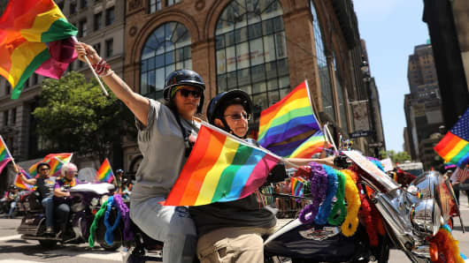 Same-sex couple rides in the Pride Parade on June 25, 2017 in New York City.