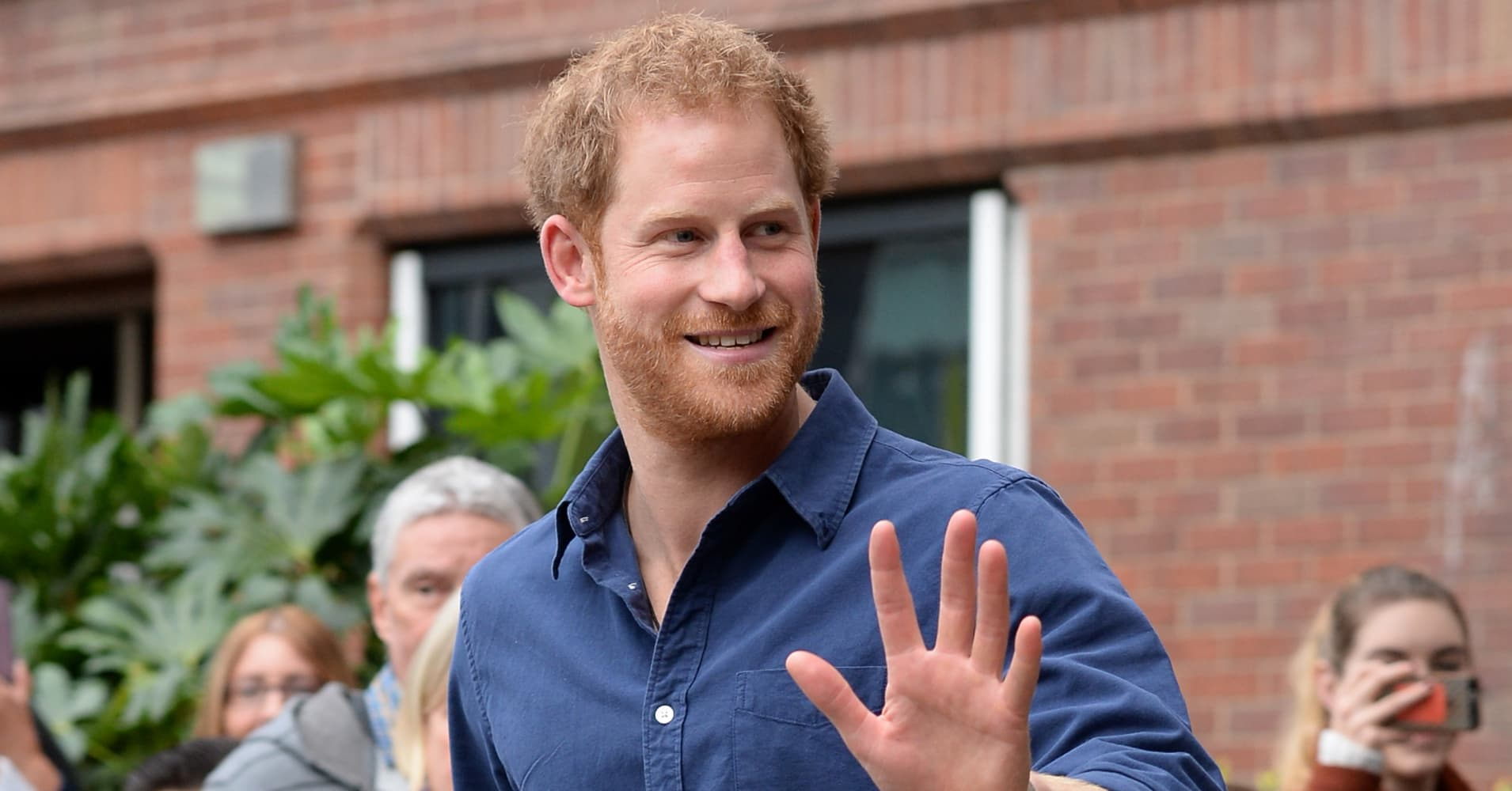 Prince Harry waves as he leaves Nottingham's new Central Police Station on October 26, 2016 in Nottingham, England.