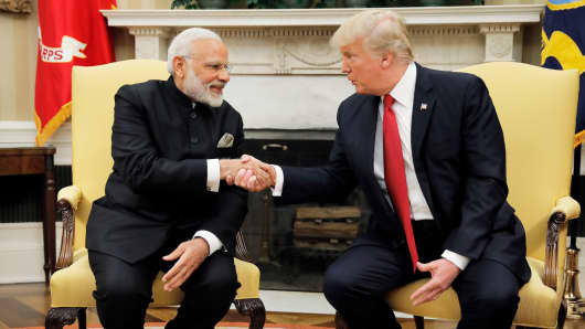 President Donald Trump shakes hands with India's Prime Minister Narendra Modi as they begin a meeting in the Oval Office of the White House in Washington, June 26, 2017.