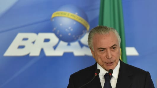 Brazilian President Michel Temer, pictured on June 26, has been charged by the country's top prosecutor of accepting bribes.