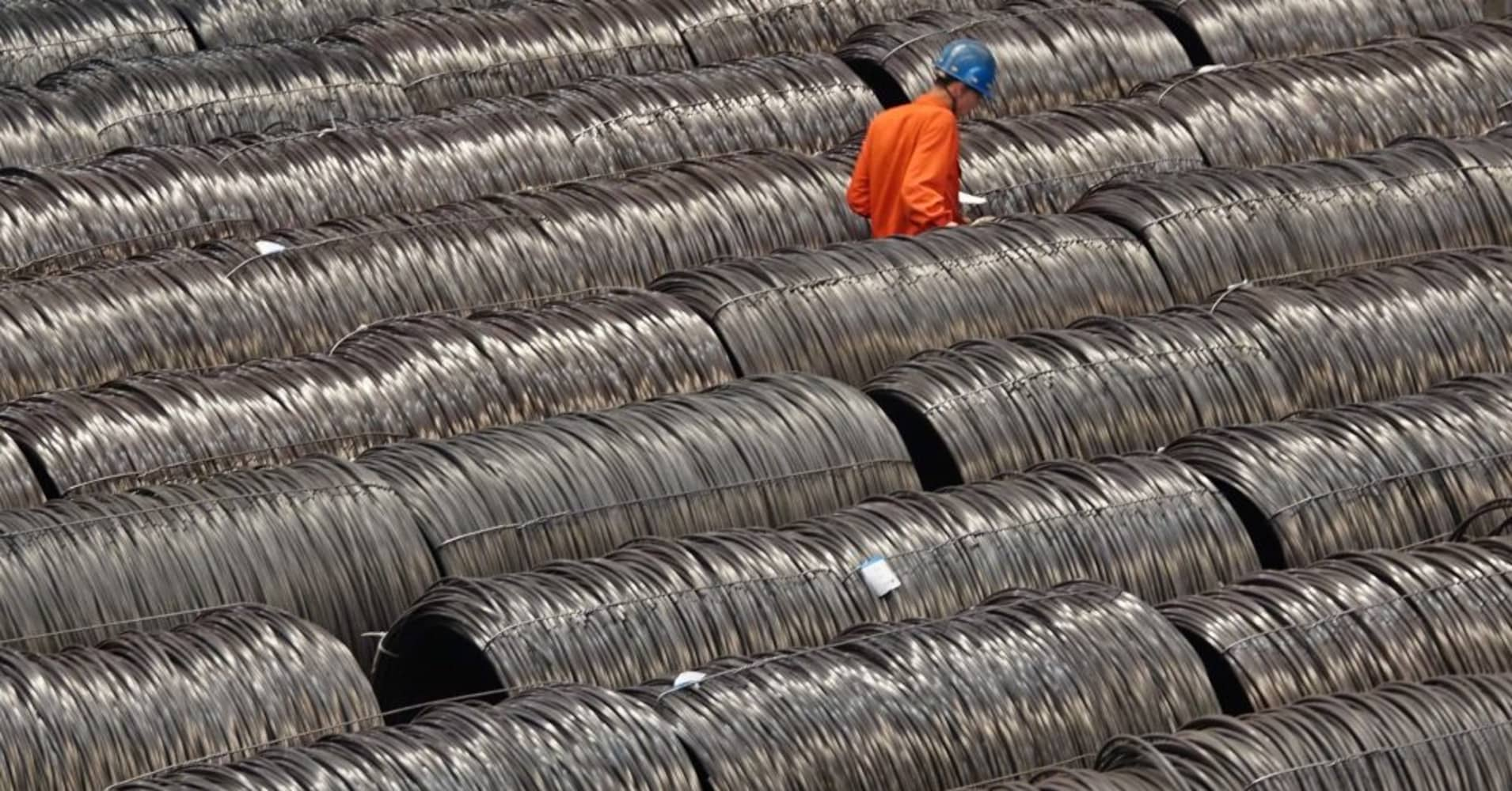 China industrial profits quicken in May, seen fading as finance costs rise