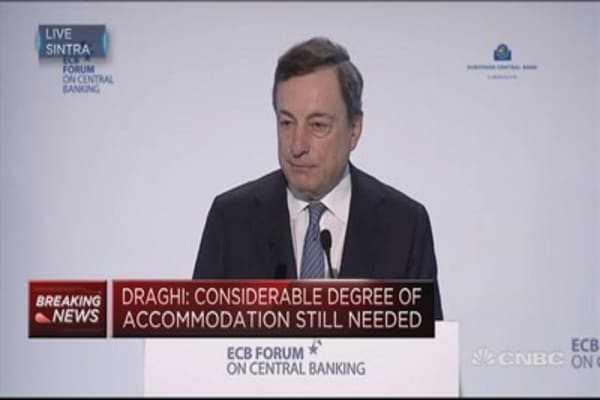 Monetary policy is working to build up reflationary pressures: ECB's Draghi