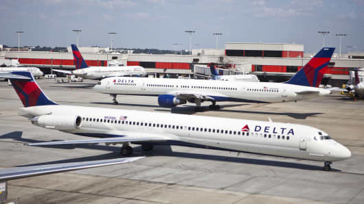 Delta Airlines planes taxi at Hartsfield Jackson Atlanta International Airport in Atlanta GA