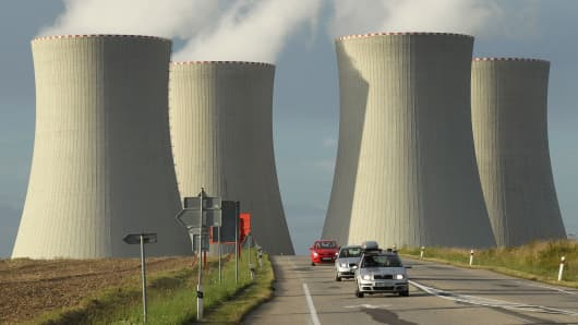 Cars drive by the four cooling towers of the Temelin nuclear power plant near Temelin, Czech Republic.