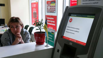 An employee sits next to an out-of-order terminal at a branch of Ukraine's state-owned bank Oschadbank, after Ukrainian institutions were hit by a wave of cyber attacks earlier in the day, in Kiev, Ukraine, June 27, 2017.
