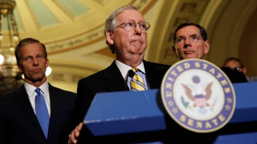 Senate Majority Leader Mitch McConnell accompanied by Sen. John Barrasso and Sen. John Thune, speaks to the media about plans to repeal and replace Obamacare on Capitol Hill in Washington