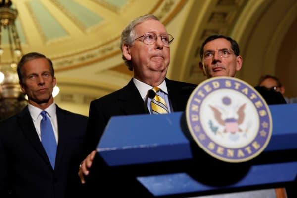 Senate Majority Leader Mitch McConnell, accompanied by Sen. John Barrasso (R-WY) and Sen. John Thune (R-SD), speaks to the media about plans to repeal and replace Obamacare on Capitol Hill in Washington, June 27, 2017.