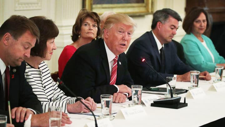 President Donald Trump (4th L) speaks as (L-R) Sen. Dean Heller (R-NV), Sen. Susan Collins (R-ME), Sen. Lisa Murkowski (R-AK), Sen. Cory Gardner (R-CO) and Sen. Deb Fischer (R-NE) listen during a meeting with Senate Republicans at the East Room of the White House June 27, 2017 in Washington, DC.