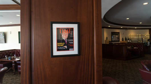 Framed portrait of President Donald Trump on the cover of a TIME Magazine hanging from a column in the Champions Sports Bar & Grill at the Trump National Doral Miami, in Doral, Florida June 24, 2017.