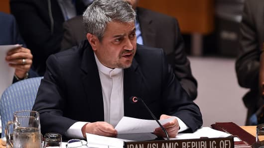 Iran's envoy to the United Nations Gholamali Khoshroo speaks during a Security Council meeting after a vote on the Iran resolution at the UN headquarters in New York on July 20, 2015. The UN Security Council on July 20, unanimously adopted a resolution that will clear a path for international sanctions crippling Iran's economy to be lifted. On condition that Iran respects the agreement to the letter, seven UN resolutions passed since 2006 to sanction Iran will be gradually terminated, according to the text.