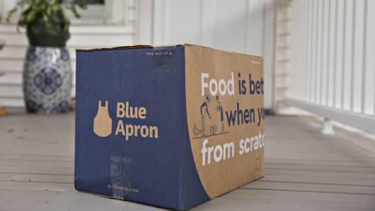 A Blue Apron Holdings Inc. meal-kit delivery package sits outside a home.