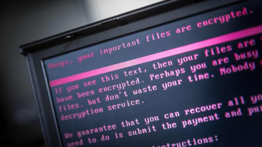 A laptop displays a message after being infected by a ransomware as part of a worldwide cyberattack on June 27, 2017