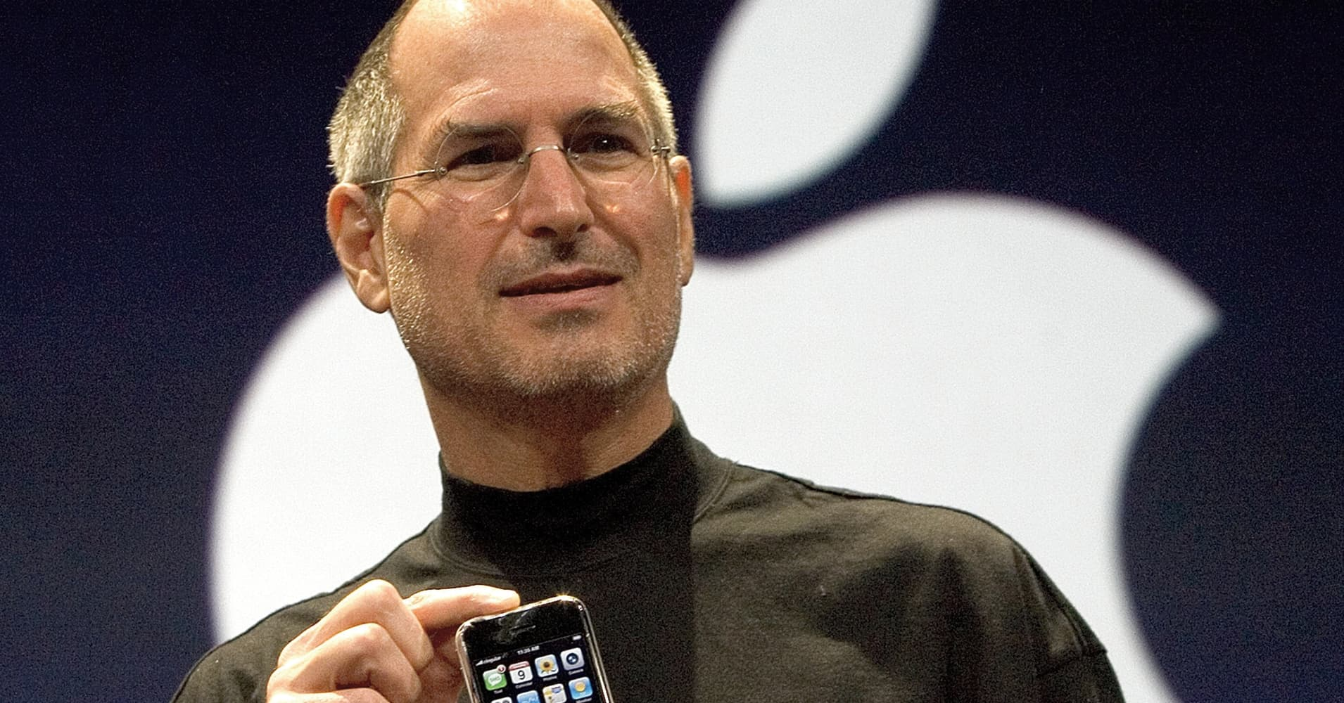 The late Steve Jobs, Apple founder and former CEO, introduces the iPhone at a conference in 2007.