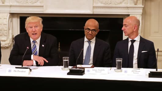 President Donald Trump, Microsoft CEO Satya Nadella and Amazon CEO Jeff Bezos attend a meeting of the American Technology Council in the State Dining Room of the White House June 19, 2017 in Washington, DC.