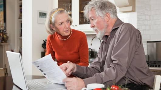 Worried retiree couple