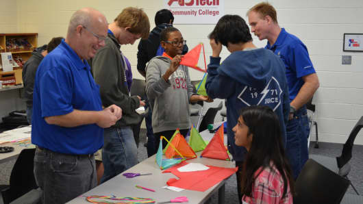 GE employees try to spark kids' interest in science, tehnology, engineering and math at the GE Asheville career day event at Asheville–Buncombe Tech Community College in North Carolina