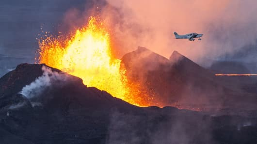 An aerial picture shows a plane flying over the Bardarbunga volcano spewing lava and smoke in southeast Iceland.