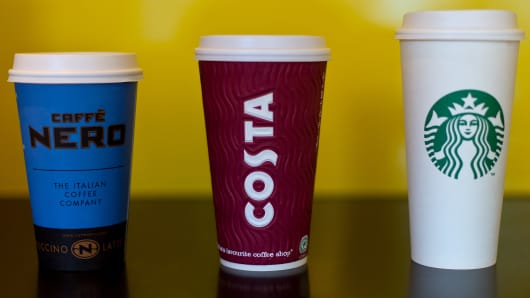 A grande Cafe Nero, large Costa Coffee and venti sized Starbucks take away cup.