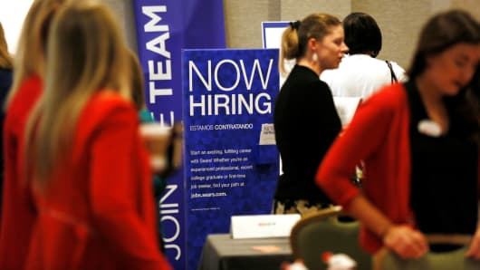 Recruiters and job seekers are seen at a job fair in Golden, Colorado.