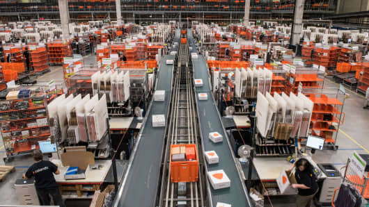 Employees pack orders at the Zalando logistics center in Erfurt, Germany.