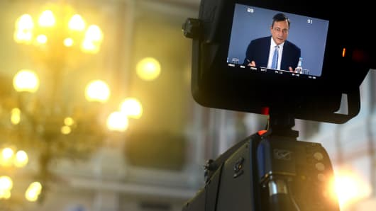 A television monitor shows Mario Draghi, president of the European Central Bank (ECB), speaking during a news conference to discuss monetary policy in Tallinn, Estonia, on Thursday, June 8, 2017.