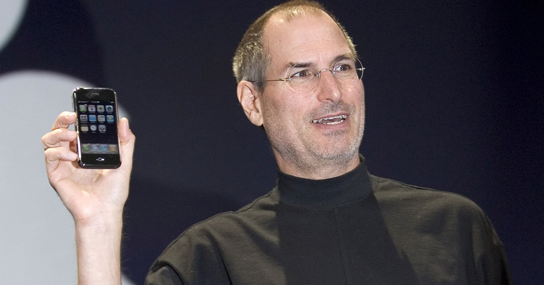 Apple CEO Steve Jobs holds up the new iPhone that was introduced at Macworld on January 9, 2007 in San Francisco, California.