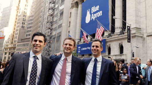 Blue Apron CEO Matthew B. Salzberg stands with co-founders Ilia Papas (L) and Matt Wadiak (R) on Wall St. ahead of the company's IPO on the New York Stock Exchange in New York, June 29, 2017.
