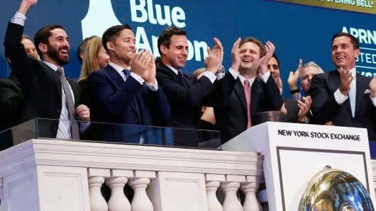 Blue Apron CEO Matthew B. Salzberg (2nd R) celebrates with co-founders Ilia Papas (R) and Matt Wadiak during the company's IPO on the New York Stock Exchange in New York, June 29, 2017.