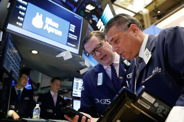 Traders work on the floor of the Exchange ahead of the Blue Apron IPO on the New York Stock Exchange in New York, June 29, 2017