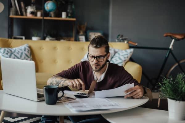 Millennial man budgeting