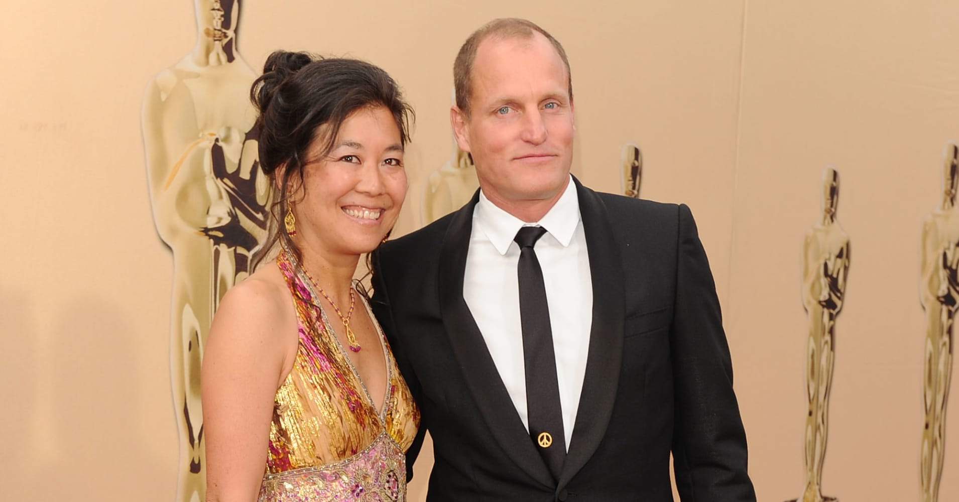 Actor Woody Harrelson and wife Laura Louie