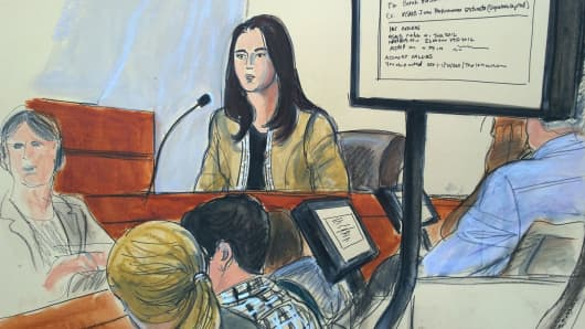 Sarah Hassan testifies with an email exhibit on the screen.